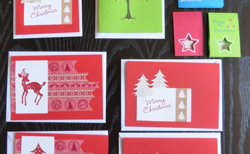 A selection of mostly red hand-made Christmas cards